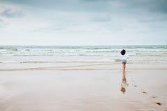 Girl enjoying the beach with bad weather Stock Photos