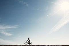 Girl enjoying bike ride silhouette Royalty Free Stock Photo