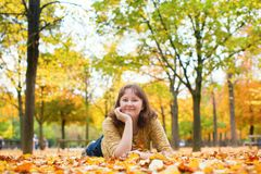 Girl enjoying bright fall day in park Royalty Free Stock Image
