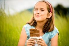 Girl enjoying chocolate Royalty Free Stock Images