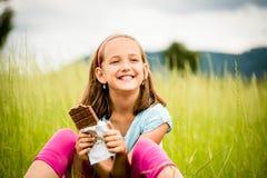 Girl enjoying chocolate Royalty Free Stock Photos
