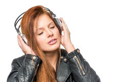 Girl enjoying a classic melody with headphones Stock Images