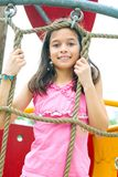 Girl enjoying climbing rope activity Royalty Free Stock Images