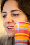 Girl Enjoying coffee at home Stock Image