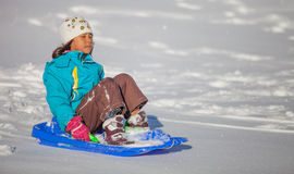 Girl Enjoying A Downhill Sled Ride III Stock Images