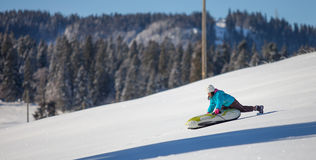 Girl Enjoying A Downhill Sled Ride IV Stock Images