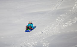 Girl Enjoying A Downhill Sled Ride Stock Images