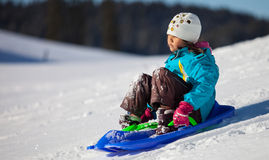 Girl Enjoying A Downhill Sled Ride V Stock Photo