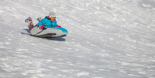 Girl Enjoying A Downhill Sled Ride VI Royalty Free Stock Photography