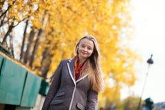Girl enjoying a fall day Royalty Free Stock Photo