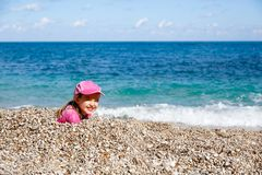 Girl enjoying free time on the beach Royalty Free Stock Images
