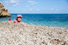 Girl enjoying free time on the beach Royalty Free Stock Photos