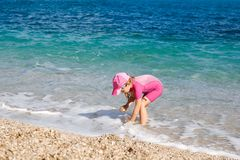 Girl enjoying free time on the beach royalty free stock image