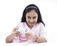 Girl enjoying gamming Stock Image