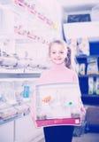 Girl  enjoying her purchase of canary bird Stock Photo