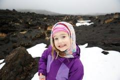 Girl enjoying herself on lava fields of Mount Etna stock photos