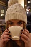 Girl enjoying hot chocolate Royalty Free Stock Photography