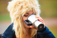 Girl enjoying hot drink outdoor Stock Images