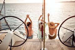 Free Girl Enjoying In Summer Days On The Luxury Yacht.Back View Stock Image - 186930431