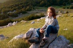 Girl enjoying last sun rays Royalty Free Stock Photography