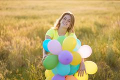 Girl enjoying the life, bright moment, summertime. Enjoy the life, birthday party, bright moment, summertime, creativeness. Young girl with big bunch of colorful royalty free stock images