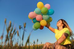 Girl enjoying the life, bright moment, summertime. Enjoy the life, birthday party, bright moment, summertime, creativeness. Young girl with big bunch of colorful royalty free stock photos