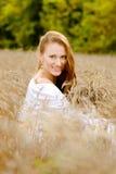 Girl enjoying life in wheat meadow Royalty Free Stock Image
