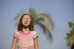 Girl enjoying the light summer rain. Stock Images