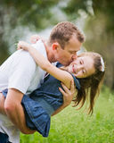A girl enjoying a moment of fun with her dad Stock Images