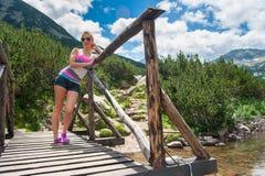 Girl Enjoying Mountain. Young pretty girl enjoying the nature on Pirin mountain, Bansko, Bulgaria Royalty Free Stock Images