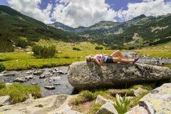 Girl Enjoying Mountain. Young pretty girl enjoying the nature on Pirin mountain, Bansko, Bulgaria Royalty Free Stock Photo