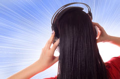 Girl enjoying the music over the blue sky Royalty Free Stock Image