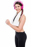 Girl enjoying music while working out Stock Images