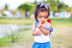 Baby girl is enjoying . Baby girl is enjoying nature royalty free stock photography