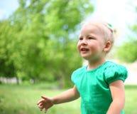 Girl enjoying nature. Girl enjoys nature running through the grass Royalty Free Stock Images