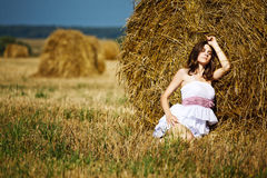 Girl enjoying the nature on fresh straw Royalty Free Stock Image