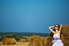 Girl enjoying the nature on fresh straw Stock Photography