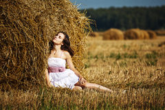Girl enjoying the nature on fresh straw Royalty Free Stock Photography