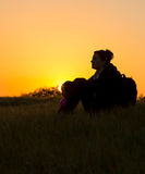 Girl enjoying nature at sunset Royalty Free Stock Photo