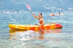 Girl enjoying paddling in kayak on the sea water Royalty Free Stock Photography
