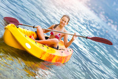 Girl enjoying paddling in kayak on the sea water Royalty Free Stock Images