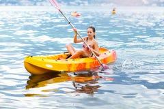 Girl enjoying paddling in kayak on the sea water Royalty Free Stock Photo