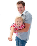 Girl enjoying piggyback ride with her father Stock Image