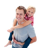 A girl enjoying piggyback ride with her father Stock Photos
