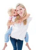 Girl enjoying piggyback ride with her mother Royalty Free Stock Photos
