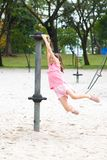 Girl enjoying the playground swing Royalty Free Stock Photography