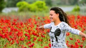 Girl enjoying in poppies field stock video footage