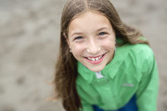 Girl enjoying the rain and having fun outside on the beach  a gray rainy Stock Image