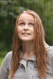 Girl enjoying rain in the park. Stock Photos