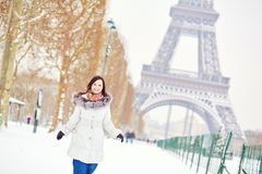 Girl enjoying rare snowy winter day in Paris Royalty Free Stock Photography
